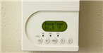 Room thermostat set to 66 degrees