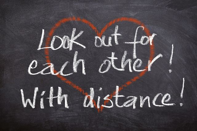&#34Look out for each other - with distance!&#34 written on a chalkboard