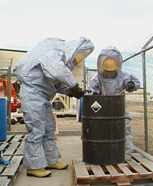 Two men in hazard material suits.