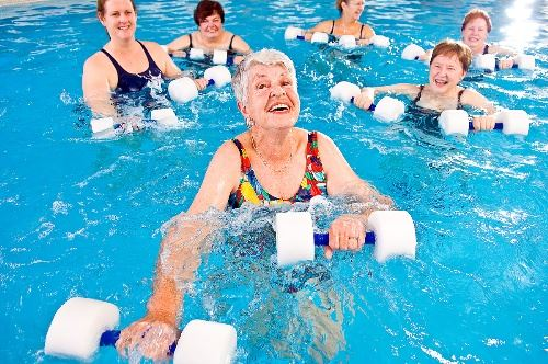 Senior participating in a water aerobics class.